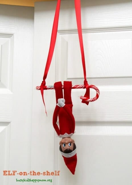 Elf swinging from a candy cane