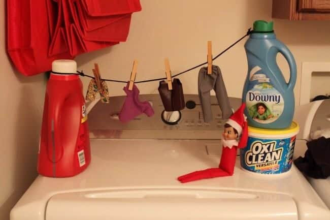 Elf hanging laundry