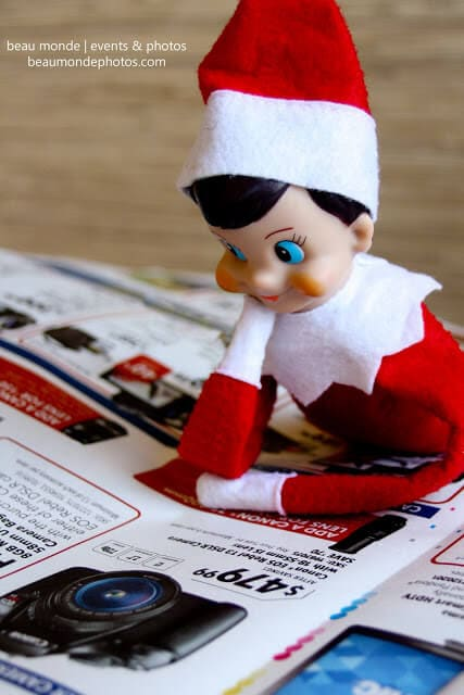 Elf looking at the paper
