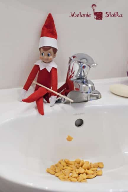 Elf fishing with gold fish