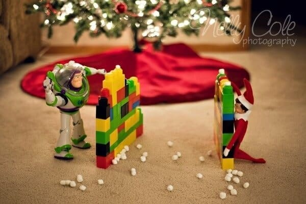 Elf doing a snowball fight with marshmallows