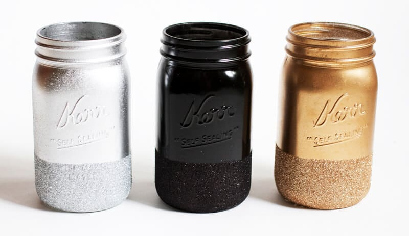 glitter dipped mason jars lined on counter