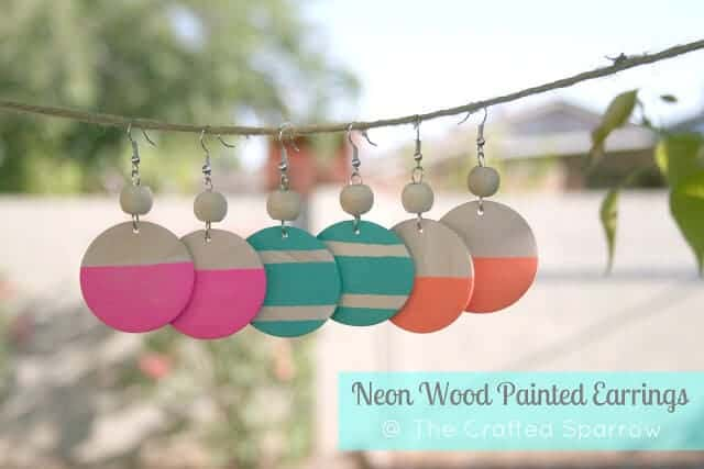 homemade wood painted earrings hanging on a burlap wire