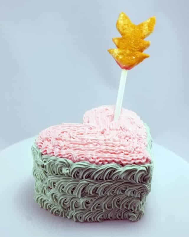 heart arrow cake on plate