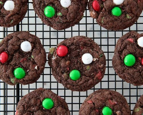 M&M chocolate mint cake mix cookies on a cooling rack