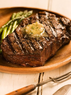 grilled steak with butter on plate