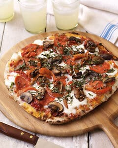 Grilled Pizza with Pepperoni & Mushrooms on plate