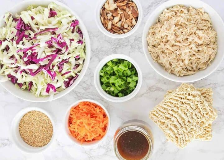 ingredients for ramen cabbage salad in bowls on the counter