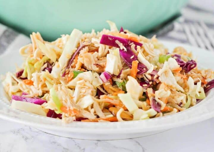 ramen noodle cabbage salad on a white plate