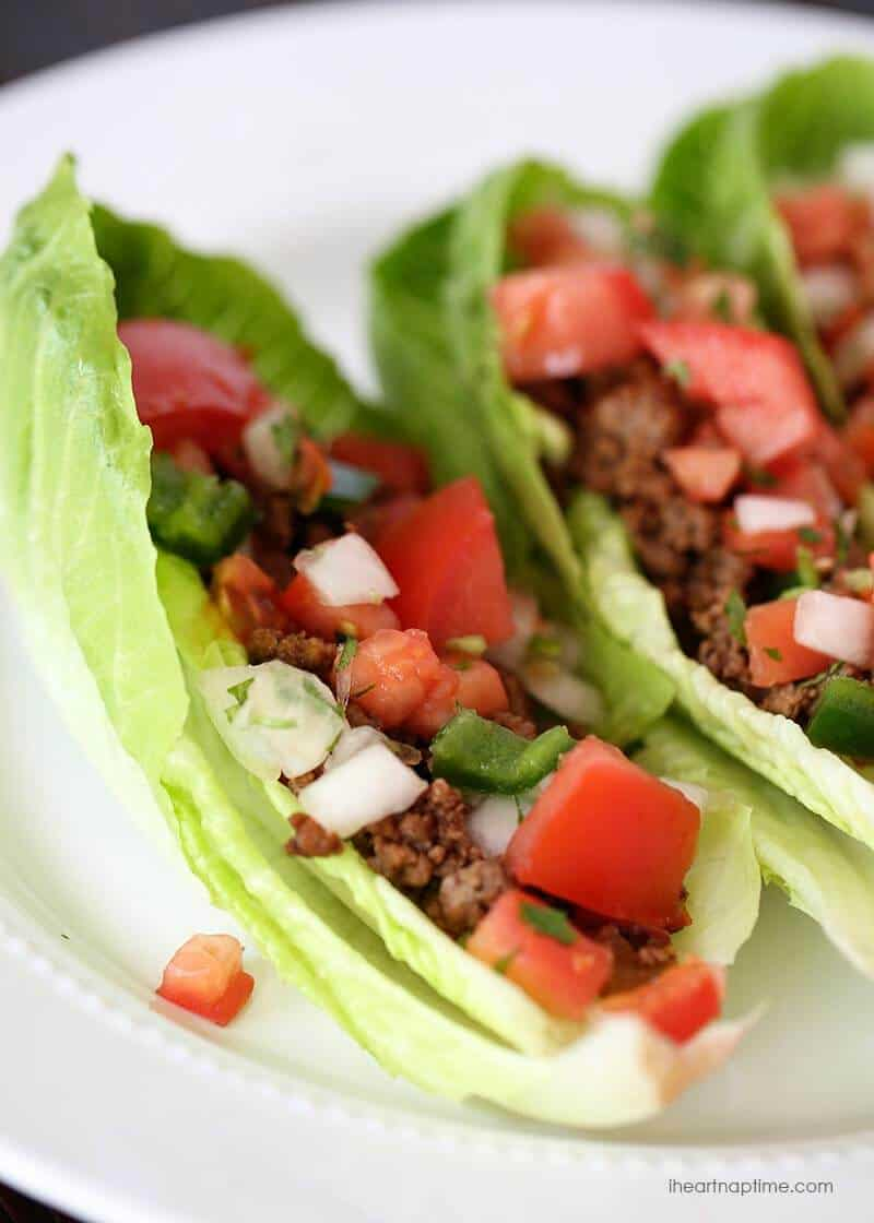 lettuce tacos on a white plate topped with pico de gallo