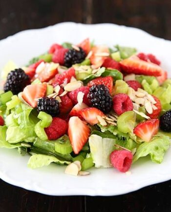 summer salad with lemon dressing on plate