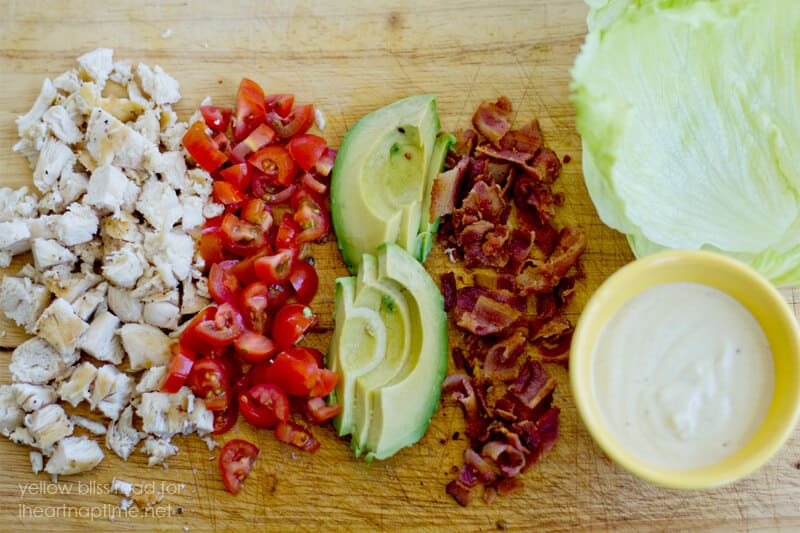 diced ingredients for chicken club wraps on cutting board