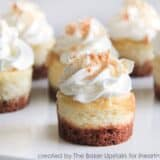 close up of mini coconut cheesecakes on plate