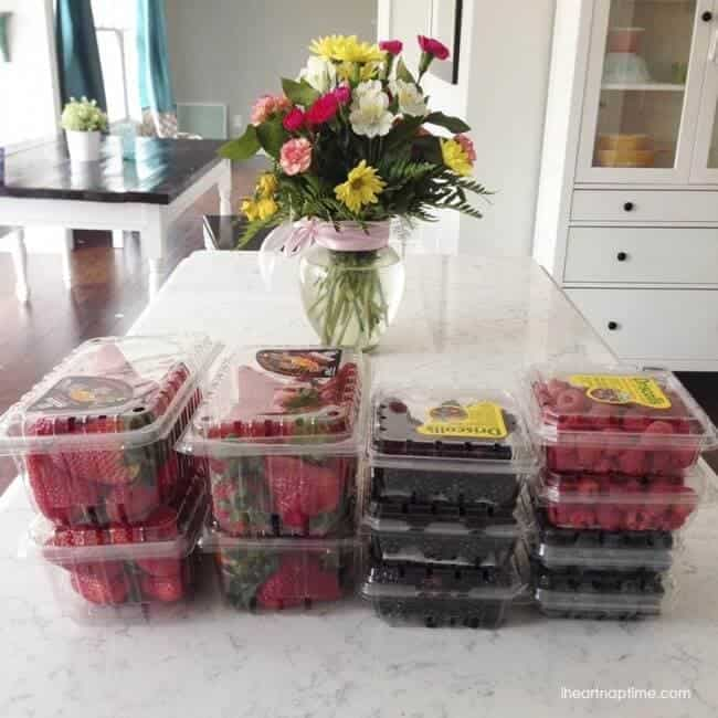 berry cartons and a vase of flowers on the counter