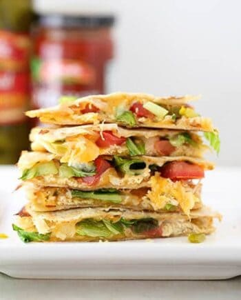 a stack of chicken quesadilla slices on plate