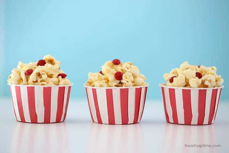 Marshmallow caramel popcorn in red and white containers