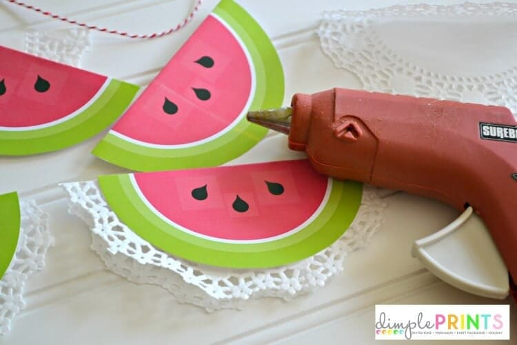 hot glue your watermelon garland onto twine