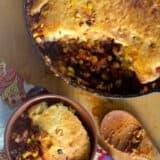 scooping chili cornbread skillet into a bowl