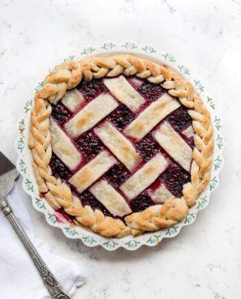 razzleberry pie with lattice crust in a pie dish