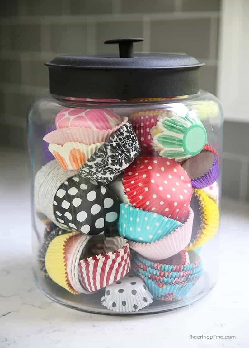 White and grey kitchen makeover on iheartnaptime.com -love the cupcake liners in jar!