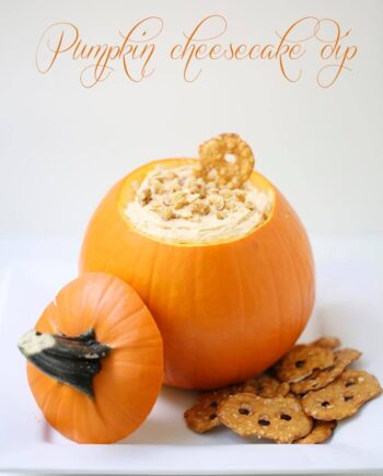 pumpkin cheesecake dip in a hollowed pumpkin