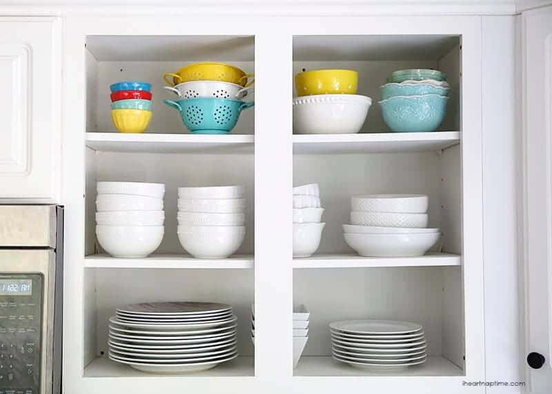 cabinets with bowls and plates inside