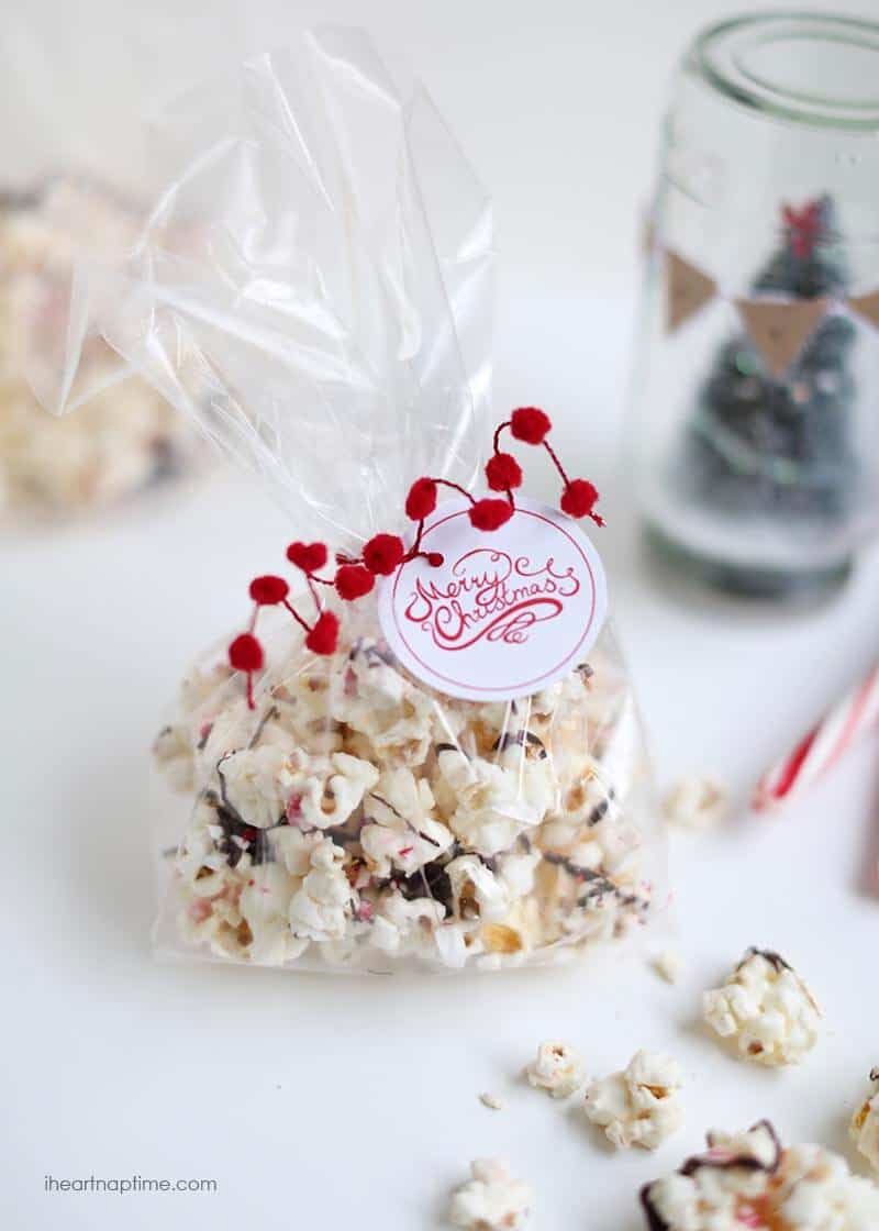 peppermint bark popcorn in a clear christmas gift bag