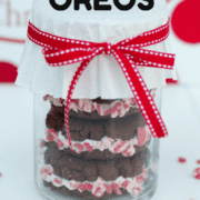 a container of peppermint oreos with a red ribbon