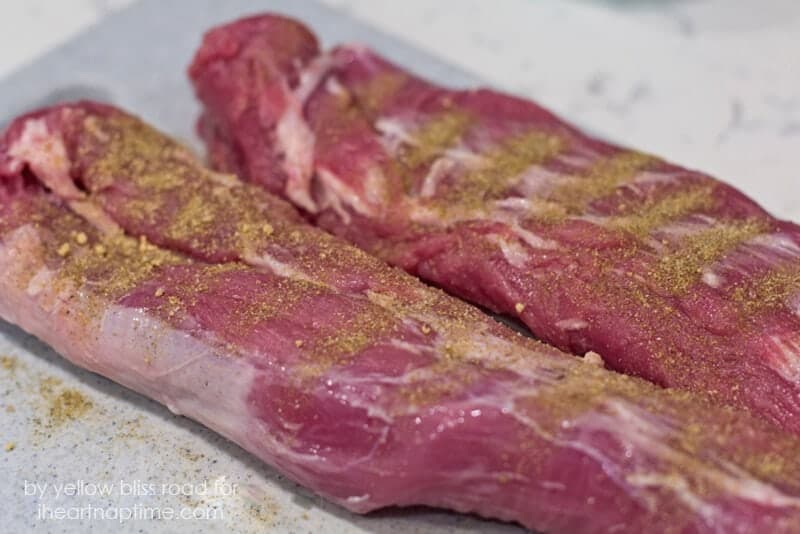 raw pork tenderloin with herbs rubbed on top
