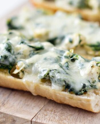 close up of spinach artichoke french bread pizza