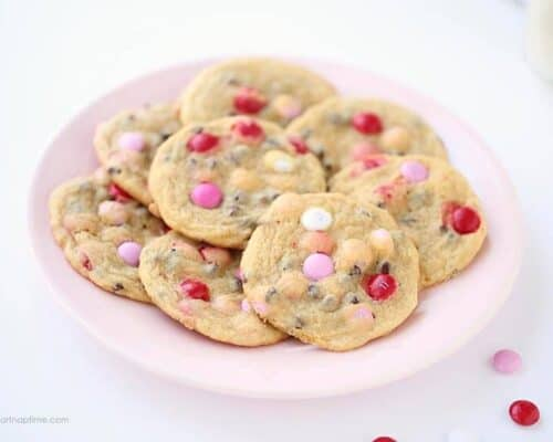 plate full of chocolate chip cookies with valentine M&M's