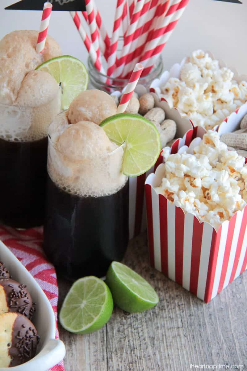 coke float on a table with popcorn