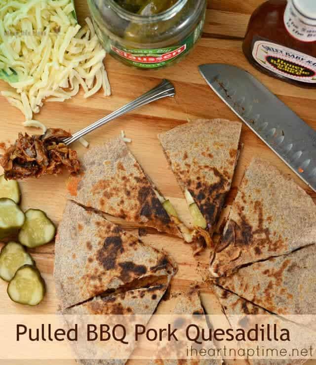 cutting pork quesadilla into sliced on cutting board
