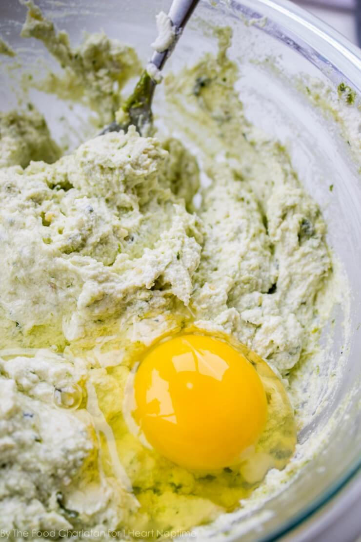 mixing together ricotta and egg