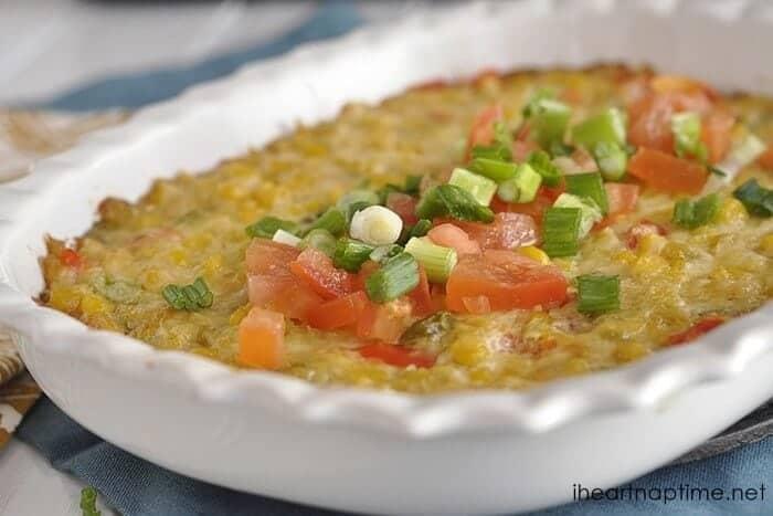 hot cheesy corn dip in a baking pan
