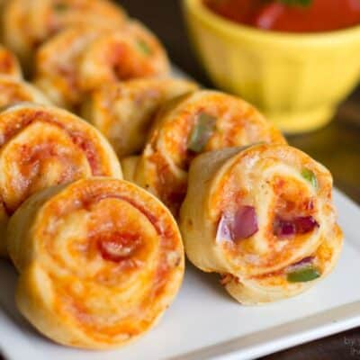 A close up of pizza pinwheels on a plate