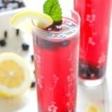 blueberry mint lemonade in a tall glass