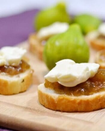 fig and brie bites on a wood board
