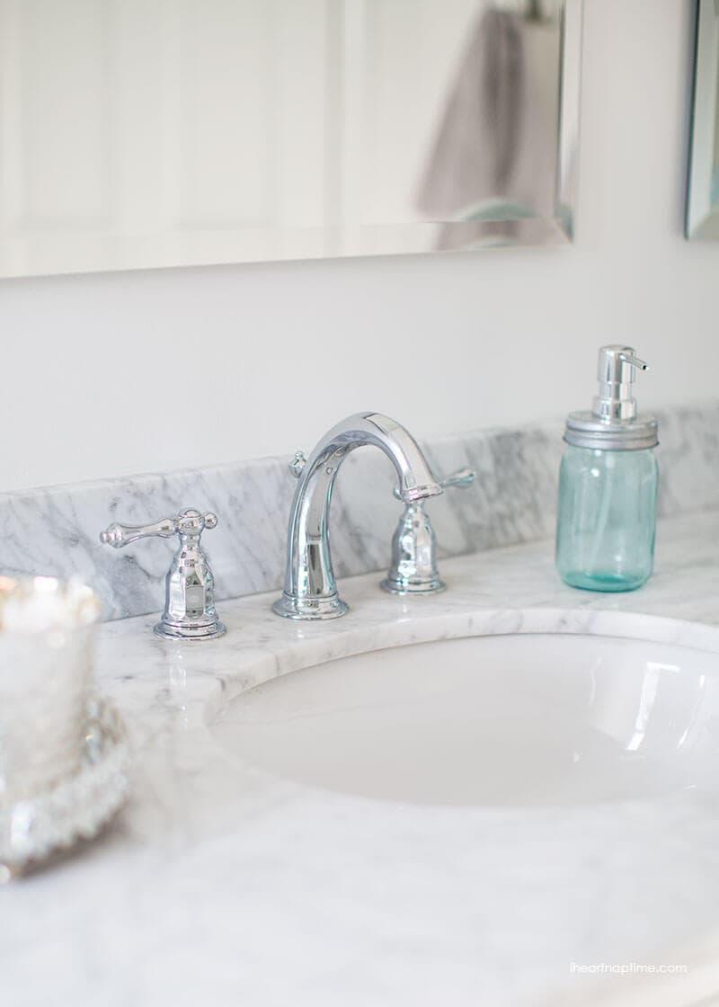 Beautiful Bathroom makeover via I Heart Naptime Grey and white bathroom remodel with Carrara marble herringbone