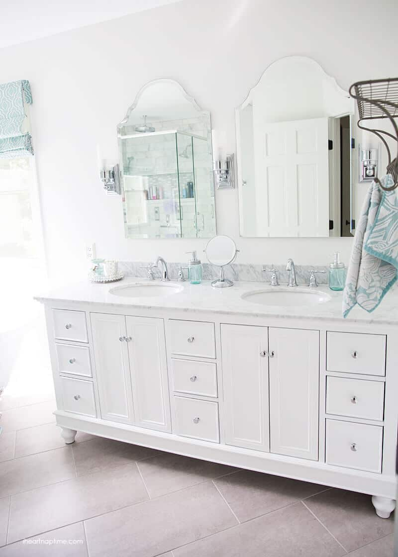 Lovely Bathroom makeover via I Heart Naptime Grey and white bathroom remodel with Carrara marble herringbone