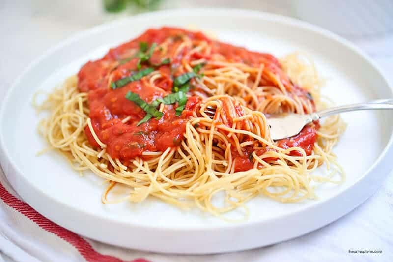 plate of spaghetti noodles with homemade tomato sauce on top