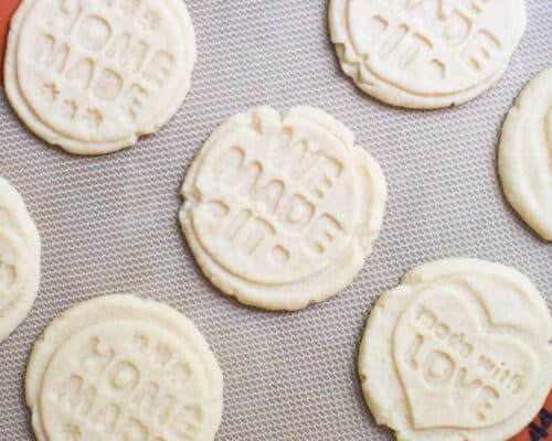 stamped shortbread cookies on a silpat mat