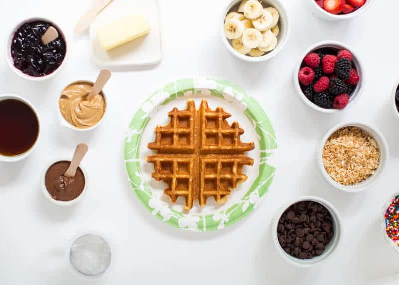 adding toppings to waffle