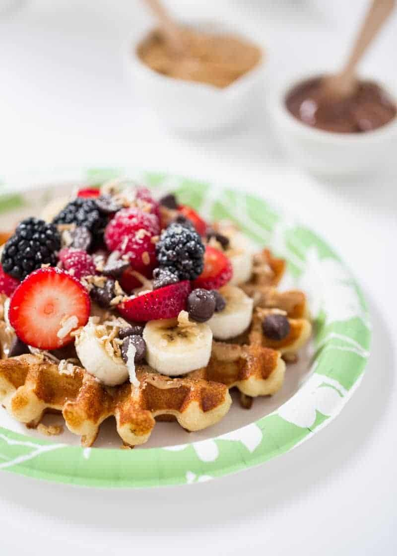 waffle topped with fresh berries, coconut and chocolate chips