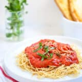 plate of spaghetti with roasted tomato sauce on top