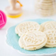 stamped shortbread cookies on a blue plate