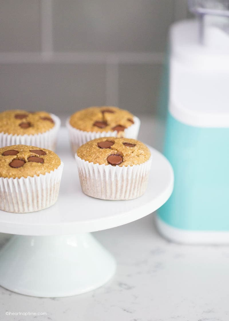 banana oatmeal muffins on a white cake stand with chocolate chips on top