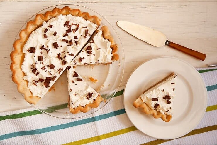 slice of caramel cream pie on white plate