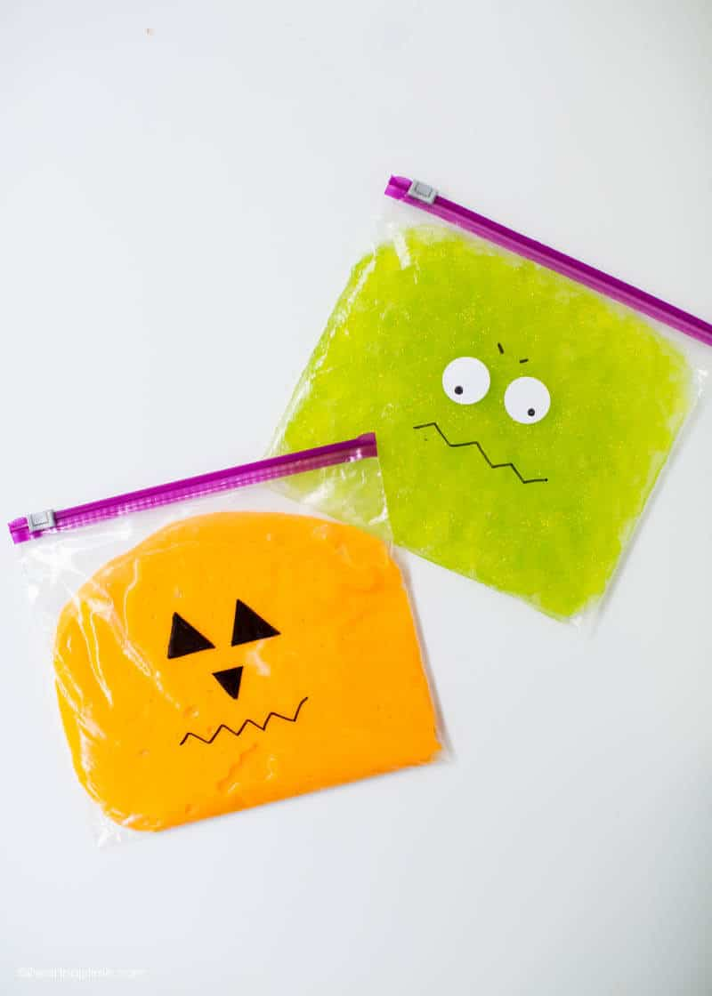 orange and green Halloween slime in a ziplock bag