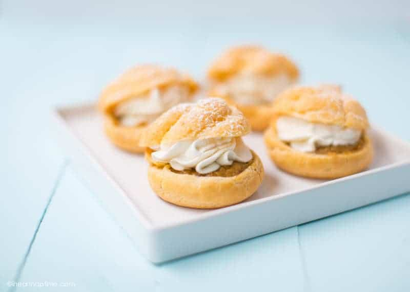 Pumpkin Pie Cream Puffs - a light and fluffy pastry filled with pumpkin pie filling and maple whipped cream! Get the recipe and instructions at iheartnaptime.com